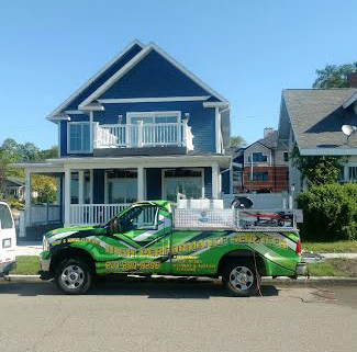 high performance services truck on a exterior house washing job